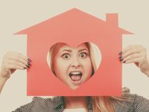 Funny girl holding red paper house with heart shape Royalty Free Stock Photo