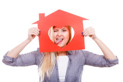 Funny girl holding red paper house with heart shape Royalty Free Stock Images