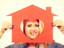 Funny girl holding red paper house with heart shape Royalty Free Stock Image