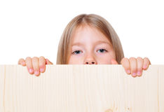 Funny girl  holds. Funny girl child holds sign Royalty Free Stock Photo