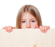 Funny girl  holds. Funny girl child holds sign Royalty Free Stock Image