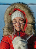 Funny girl with an icicle. Royalty Free Stock Image