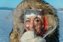Funny girl with an icicle. Royalty Free Stock Photography