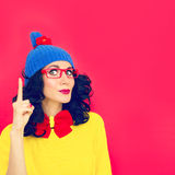 Funny girl with index finger Stock Photo