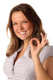 Funny girl indicating OK sign on white background Stock Photography