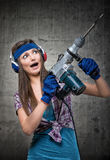 Funny girl with a jackhammer Stock Photos