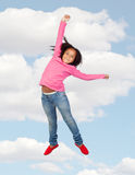 Funny girl jumping to the sky Stock Photo