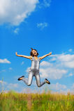 Funny girl jumps up Royalty Free Stock Photography