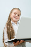 Funny girl with laptop indoors Stock Photography