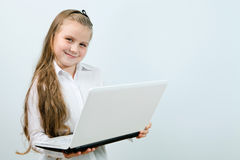 Funny girl with laptop indoors Stock Images