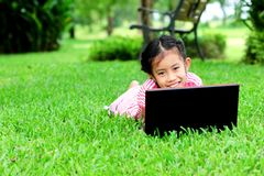 Funny girl with a laptop in the park Royalty Free Stock Photos