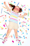 Funny girl laying among school office supplies Royalty Free Stock Photography