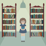 Funny girl in a library. Stock Photos