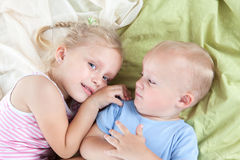 Funny girl with little brother Stock Photography