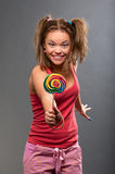 Funny girl with lollipop Royalty Free Stock Photography