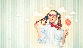 Funny girl with lollipop Stock Photography