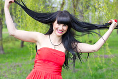 Funny girl with long hair. At the park Royalty Free Stock Photos