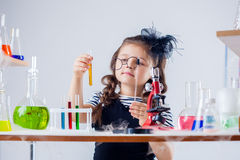 Funny girl looking through her glasses at tube Royalty Free Stock Photo