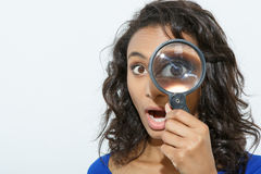 Funny girl with loupe Royalty Free Stock Photography
