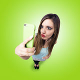 Funny girl make a duck face, and take a self portrait with her s Royalty Free Stock Photo