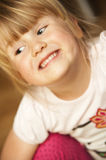 Funny girl making faces stock images