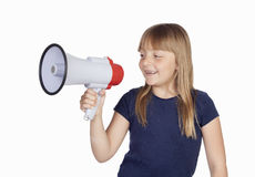 Funny girl with a megaphone Stock Photography