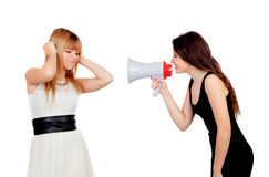 Funny girl with a megaphone talking to her friend Stock Image