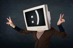 Funny girl with a monitor box on her head and a smiley face Royalty Free Stock Photography