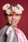 Funny girl in a mouse costume. Beautiful girl in a mouse costume on a claret background Stock Photos