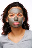 A funny girl with mud mask stock images