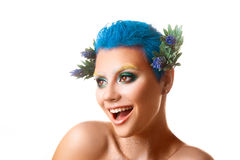 Funny girl with multicolor makeup smiling on white background Royalty Free Stock Photography