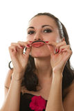 Funny girl with a mustache out of the hair Royalty Free Stock Photo