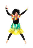 Funny girl in native costume and wig jumping isolated Stock Images