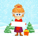 Funny girl and New Year symbol. Funny red-haired girl in goat mask is keeping in her hands greeting banner, and colorful gift box and fir trees around Royalty Free Stock Image
