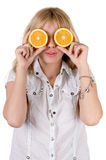 Funny girl with oranges Royalty Free Stock Images