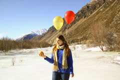 Funny girl with oranges and balloons on the hair Royalty Free Stock Photo