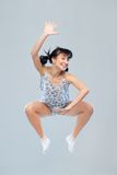 Funny girl in pajamas jumping for happiness Stock Image
