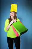Funny girl paper shopping bag on head. Sales. Stock Photos