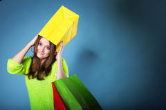 Funny girl paper shopping bag on head. Sales. Stock Photo
