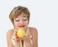 Funny girl with a pear Stock Photo