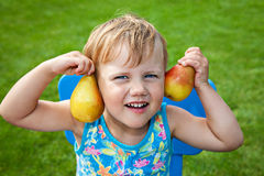 Funny girl with pears Stock Photos