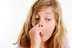 Funny girl picking in nose. In front of white background Stock Photo