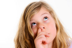 Funny girl picking in nose. In front of white background Stock Photos