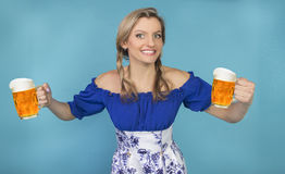 Funny girl with pigtails and glasses of beer Royalty Free Stock Images