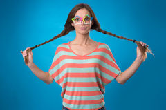 Funny girl with pigtails Stock Images