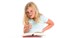Funny girl with pile of books and round glasses Royalty Free Stock Photography