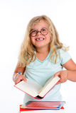 Funny girl with pile of books and round glasses Stock Images