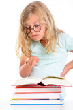 Funny girl with pile of books and round glasses Stock Photography