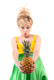 Funny girl with pineapple isolated on white Stock Photos