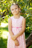 Funny girl in a pink dress Stock Photos